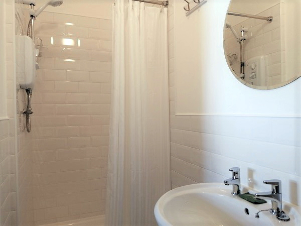 En-suite with shower, basin and WC